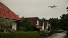 Aircraft flying over Houses Stock Footage