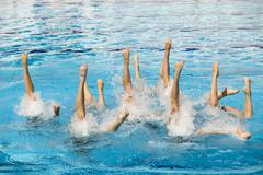synchronized swimming - stock photo