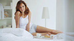 Young brunette gentle stretching after waking up in the morning Stock Footage