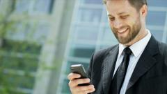 Male Caucasian Financial Advisor Smart Phone City Outdoors - stock footage