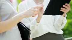 Close Up Caucasian Businesswomen Using Wireless Hot Spot Outdoors Stock Footage