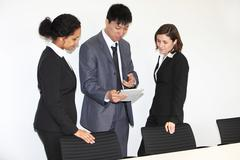 three businesspeople having a discussion - stock photo