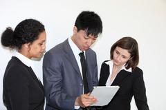 Business colleaues consulting a tablet-pc Stock Photos