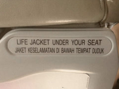 Life Jacket Sign on Back of Airplane Seat Stock Video Stock Footage