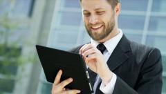 Male Caucasian Financial Advisor Tablet Hot Spot City Outdoors Stock Footage