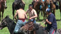 Wrestling on horseback in Kyrgyz village, two men fighting, Central Asia Stock Footage
