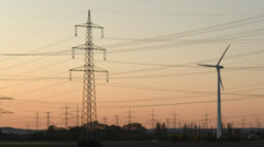 Sunset with electrical power supply - stock footage