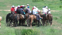 Ulak-tartysh players prepare for a game in Kyrgyz village Stock Footage