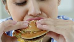 Hamburger eater Stock Footage