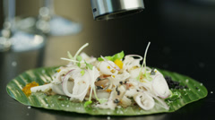 Chef Seasoning Salad with Slices of Fresh Fish and Onion 4K - stock footage