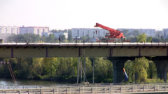 Crane on a bridge a hot day Stock Footage
