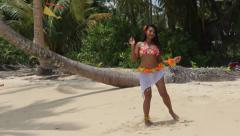 Hula Hawaii dancer dancing in the tropical nature Stock Footage
