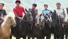 Men on horseback wait for game of 'ulak-tartysh', Central Asia tradition Stock Footage