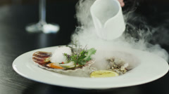 Chef Garnishing Scallops with Dry Ice in Luxury Restaurant. 4K Stock Footage