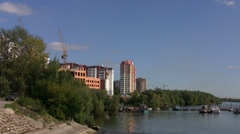 Construction site on a river bank in Russia Stock Footage