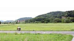 Cycling on a long distance Stock Footage