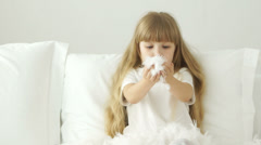 Funny little girl playing with pillow feathers and laughing - stock footage