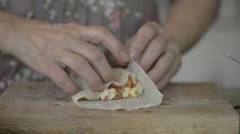 Wrapping Asia spring roll Stock Footage