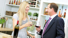 Blonde Caucasian Couple After Work Drinking Red Wine Kitchen Stock Footage