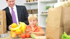 Young Blonde Caucasian Children Parents Kitchen Fresh Fruit - stock footage