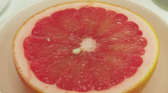 grapefruit rotating in white bowl - stock footage