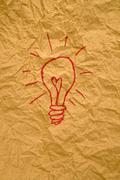 idea light bulb on paper - stock photo