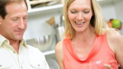 Blonde Caucasian Couple Using Wireless Tablet Food Recipe - stock footage