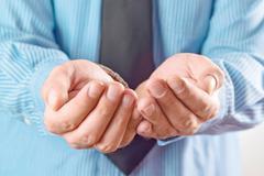Businessman asking for money Stock Photos