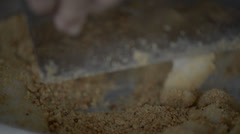 Mixing mochi with peanut powder Stock Footage