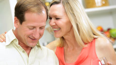 Close Up Relaxed Blonde Caucasian Couple Drinking Wine Kitchen - stock footage