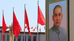Red flag and portrait of Sun Zhongshan,in Tiananmen square Stock Footage