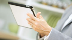Close Up Hands Blonde Caucasian Businesswoman Using Tablet News Success - stock footage