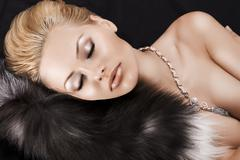 Stock Photo of sleeping blonde beauty on fur