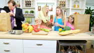 Stock Video Footage of Healthy Blonde Caucasian Family Unpacking Fresh Organic Produce