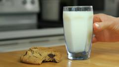 Chocolate chip cookies and milk, person grabs milk Stock Footage