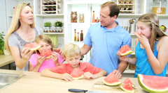 Blonde Caucasian Family Group Kitchen Enjoying Juicy Watermelon Stock Footage