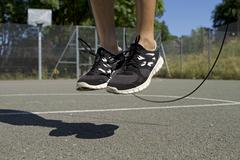 Man skipping with a jump rope - stock photo