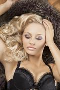 sensual woman with blond curly hair - stock photo