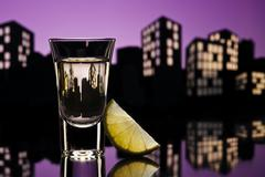 Tequila shoot in cityscape setting Stock Illustration