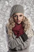 Wonderful blonde girl in woolen winter clothes Stock Photos