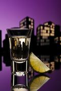tequila shoot in cityscape setting - stock illustration