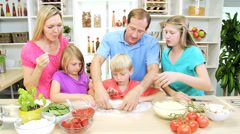 Young Blonde Caucasian Family Preparing Homemade Pizza Lunch - stock footage