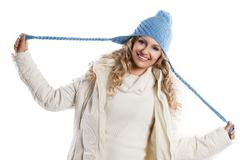 blue hat on a blond girl, playing with the  hat's braids - stock photo