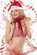 Sexy santa claus and candy canes Stock Photos
