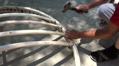 Constructing a 'tunduk', the rooftop of a yurt, by hand, in Central Asia Stock Footage