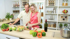 Healthy Blonde Caucasian Couple Kitchen Fresh Vegetables - stock footage