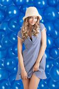 fashion shot of summer girl in blue, she smiles - stock photo