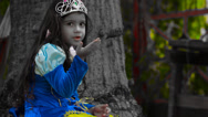 Stock Video Footage of Little girl Snow White Fairy tale sitting next to old tree