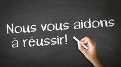 we help you succeed (in french) - stock photo