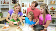 Stock Video Footage of Parents Children Kitchen Baking Homemade Cakes